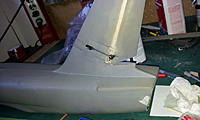 Name: 20130124_091041.jpg Views: 76 Size: 200.4 KB Description: Servo glued in place with linkage and custom horn.