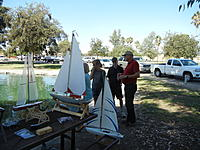 Name: Walk-up Family gets to try rc sailing.jpg