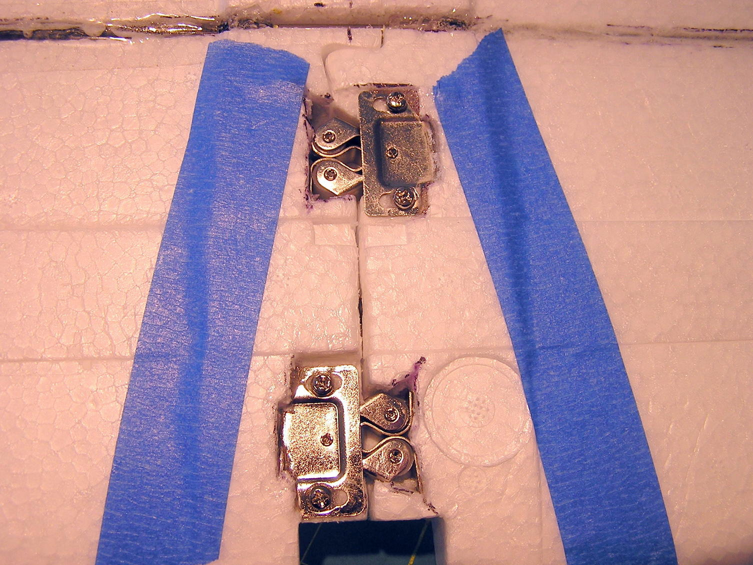 Name: 2 latches (3).jpg Views: 939 Size: 304.7 KB Description: Pair of Cabinet latches added to connect the wings.   Glued in place with medium CA.  Screws used to distribute the load in the foam.