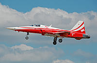 Name: Patrouille_Suisse_Northrop_F-5E_Tiger_II_(J-3082)_arrives_RIAT_Fairford_10thJuly2014_arp.jpg