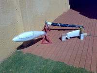 Name: Ventus building group project 021.jpg Views: 551 Size: 94.2 KB Description: The 3 main parts , pod,boom and fin, I neede to wrap the boom in black plastic to get a cure during a cold snap, a few weeks back.