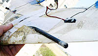 Name: FOLDING_WING_C.jpg Views: 224 Size: 38.6 KB Description: here you can see carbon slides into wider carbon to hold the halves and bottom of the wing is all taped
