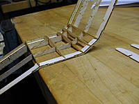 Name: SpookE 12.jpg Views: 85 Size: 58.8 KB Description: The gull section ribs are inserted and tack glued with this section of the wing supported on the edge of the workbench.