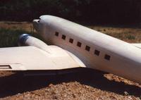 Name: DC-3 C0001.jpg Views: 355 Size: 56.0 KB Description: Fuselage prior to final sanding.