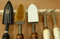 Name: IRONS.jpg Views: 361 Size: 68.9 KB Description: L to R: 1 - Coverite iron for tacking and shrinking open bays. 2 - Used felt covered Iron for use on sheeted wood. 3 - Iron with new felt. 4 & 5 - Top Flight flat and round trim-seal.