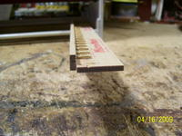 Name: Athena rails 002.jpg Views: 160 Size: 73.1 KB Description: A widish piece of basswood with a line down the middle and holes drilled every half inch glued to a piece of yard stick.