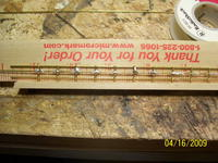 Name: Athena rails 007.jpg Views: 169 Size: 115.8 KB Description: Third rail soldered (not so neatly) holding the whole rail assembly together. Painting will hold the top and bottom rails in place. Next is filing off the excess solder at the joints.