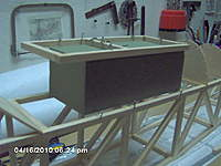 Name: IM000696.jpg Views: 435 Size: 117.5 KB Description: Foam block to set the upper cabin parts in position as it small er than the fuselage sides.