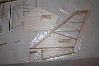 Name: IMG_1800.jpg Views: 166 Size: 159.6 KB Description: First stage of fin construction, inset ply patches fitted.  Drive crank bottom left