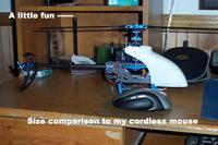 Name: next_to_mouse.jpg Views: 358 Size: 85.6 KB Description: size comparison of 95% complete heli next to cordless mouse