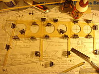 Name: DSC05103.jpg Views: 133 Size: 268.3 KB Description: I use a magnet building system which I have use with great success.  I figured out how to arrange the magnets to hold down parts and keep them in place without  punching holes in the wood.
