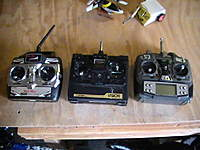 Name: PIC_1712.jpg Views: 429 Size: 59.1 KB Description: The collection of radios I have. The radio on the left is my only 2.4 radio.