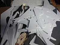 Name: a4098236-87-DSC00485.jpg Views: 101 Size: 117.3 KB Description: All the foam cut for a Super hero