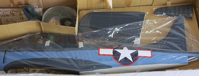 The complete kit contents, including painted pilots, guns and a fiberglass cowl.