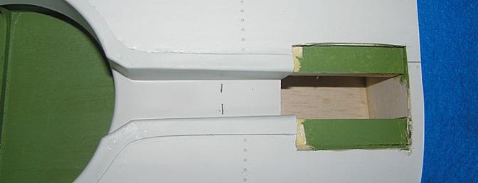Plastic wheel well had to be trimmed to permit the retract unit to fit. Note the dotted line. This section also has to be painted, after all we wouldn't want this plastic to corrode in the salt water breeze while sitting on the carrier.
