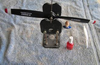 A Master Airscrew 14-6 prop was balanced with a DuBro Prop Balancer. Red nail polish was used to bring the prop into proper balance.