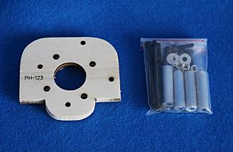 Motor mount for electric motor with spacers.