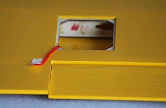 Access panel removed shows red thread to guide your aileron cable to the wing root.
