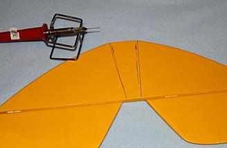 Hot knife was used to remove ORACOVER from horizontal stabilizer so epoxy would have a wood to wood joint.