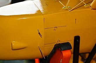 """Toothpicks and """"T"""" pins assist in holding cowl in place while other holes are drilled."""