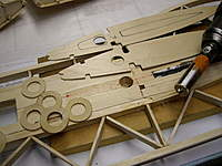 """Name: IMGP0990_resize.jpg Views: 174 Size: 57.8 KB Description: Here is the attachment kit.  1/16"""" copies of the root rib.  A custom tool to make the holes for the wing tube socket, some washers to attach the tube, and the hole in the fuselage."""