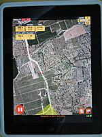 """Name: Tortosa_23.jpg Views: 503 Size: 190.3 KB Description: This is the interface of the new """"Skynavigator for IPad-App"""". You see the Google-Earth-picture of the flying site. The triangle shown by green lines, the plane as an """"arrow"""", it's trace shown as dots - red for sinking, blue for rising"""