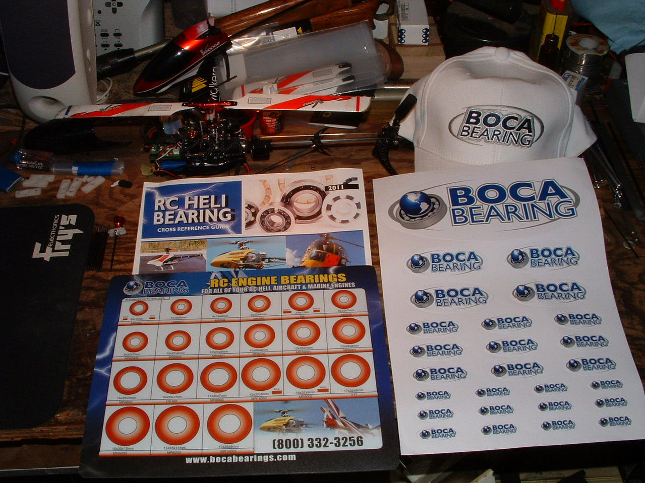 Name: DSCF0142.jpg Views: 198 Size: 212.1 KB Description: I recieved all this from Boca bearings free of charge for writing this bearing information in my blog. There is a hat,stickers,cool mouse pad and heli bearing kit price brochure.