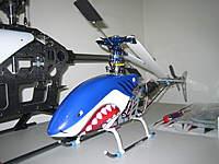 Name: IMG_5005.jpg Views: 119 Size: 81.4 KB Description: TREX 450v2 Circa 2008. CarbonFiber frame and CNC Rotor Head.