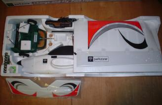 A shot of the packaging and parts in the tray.