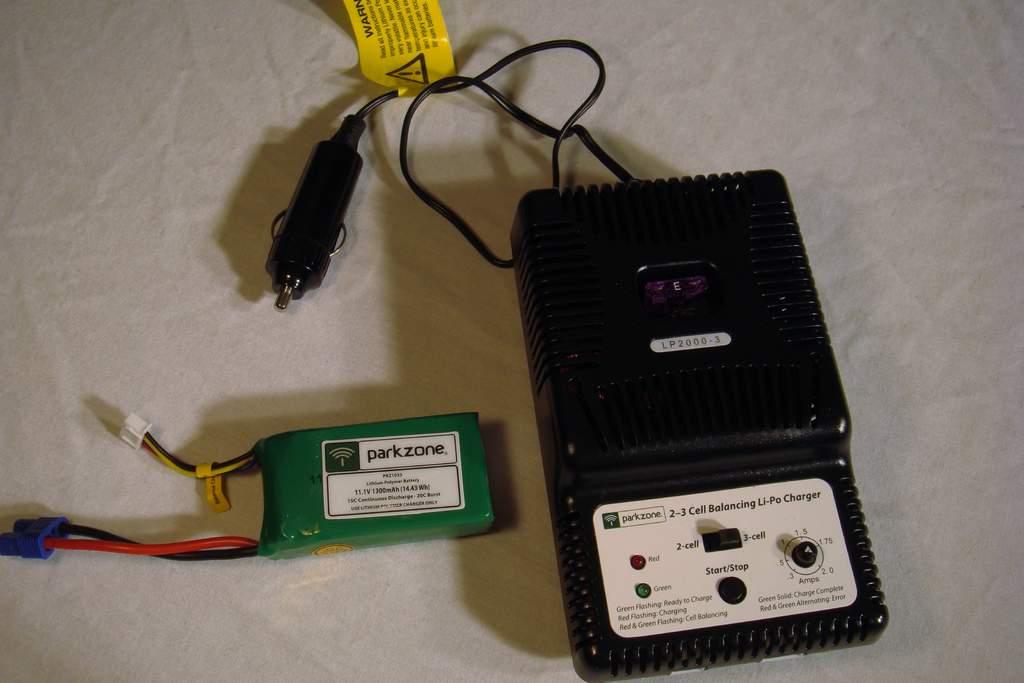 Name: DSC03026.jpg Views: 847 Size: 53.2 KB Description: Flight battery and DC charger.
