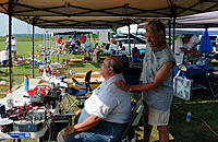 Name: DSC_0397.jpg Views: 75 Size: 299.4 KB Description: Steve Staples was running his sunblock salon to help keep everyone from getting toasted and here he gives Tom Blakeney a touch up.