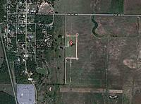 """Name: FARM Club Field SAT.jpg Views: 127 Size: 114.5 KB Description: Satellite view of the field. Huge space to the north, east, and south of the runway. """"A"""" is the middle of the runway"""