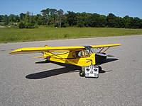 Name: DSC05715.jpg Views: 239 Size: 121.1 KB Description: Great Planes Cub .60 size with an E-Flight Power 90 - 7S battery