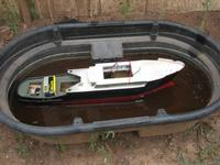Name: IMG_0524.jpg Views: 152 Size: 49.6 KB Description: 1 fence charger battery and 200 rounds of caliber 535 and she is still not deep enough in the water