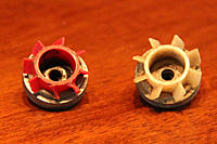 Name: Flywheels_1.jpg Views: 75 Size: 69.2 KB Description: 14.  Geared flywheels? :: Red one has broken fins, white one has goop on it.  I have no idea what these are for.  Maybe you do.