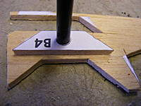 Name: DSCF6445.jpg Views: 436 Size: 81.9 KB Description: Using a carbon tube to align the hole before cutting the outer edges to shape