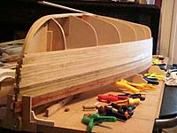 Name: DSC01427.jpg Views: 246 Size: 38.9 KB Description: Planks are held in place with a multitude of clamps untill the epoxy is set.