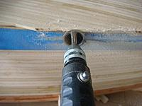 Name: DSC01498.jpg Views: 212 Size: 73.4 KB Description: Trimming the aft planks with a diamond cutting wheel with a spacer on the shaft center to keep the spacing I want.