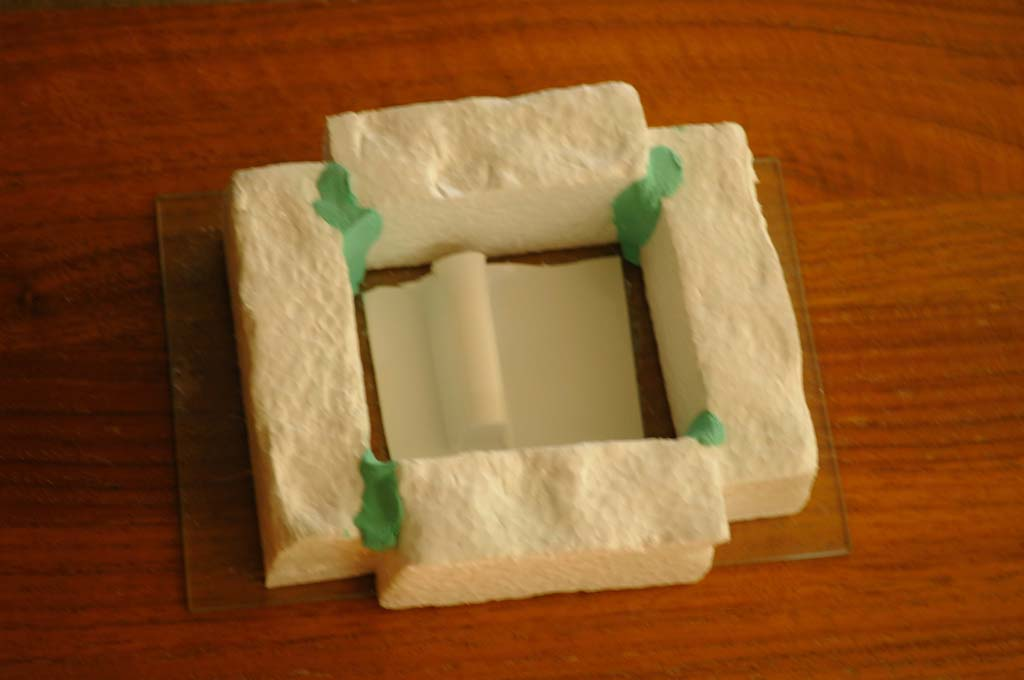 Name: DSC_7340.jpg Views: 320 Size: 71.9 KB Description: Styrofoam dam build around plastic servo cover from an old kit. Molding clay keeps the seams legit