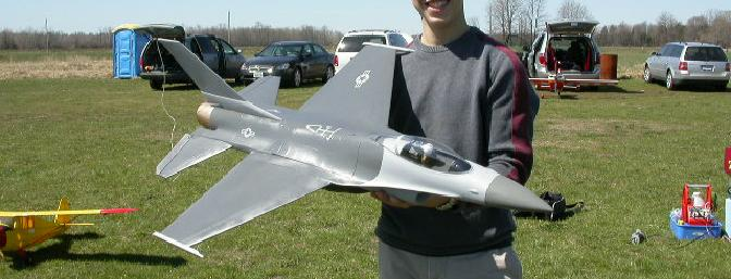 Adam with his model before the maiden flight.