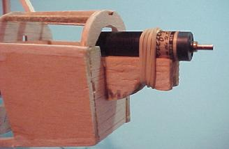 The Firefly motor in the motor mount, held on with an elastic.