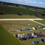 This photo is a closer shot of the funfly, runway, parking and vendors.