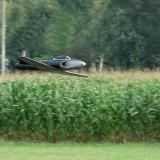 A brushless-powered and custom-painted Kyosho T-33 ducted fan jet speeds by in a low pass over the field.