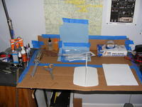 Name: DSCF7457.jpg Views: 297 Size: 85.1 KB Description: My building space. The paper towels are to protect the walls from the CA Kicker. That is a homemade tail stand in the center. I didn't want to ruin the rudder.