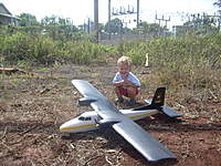 Name: Logan 9-14-2008- Logan at the field with RC planes and cars (1).jpg