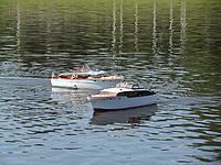Name: Spring Lake - 2011 050.jpg Views: 132 Size: 305.0 KB Description: The two Corvettes passing close