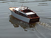 Name: Spring Lake - 2011 028.jpg Views: 152 Size: 168.7 KB Description: The boat was built for 12 volts but I stole the battery from it to put in the resque tug today so it is running on 6 volts.  I am sure to get more out of it when I get another 12 volt battery.
