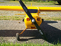 Name: J-3Noseshot.jpg Views: 108 Size: 167.6 KB Description: Aaahh..windshield on. I think the little plastic motors are what really make it look like a J-3
