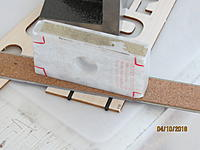 Name: IMG_2764.JPG Views: 146 Size: 2.02 MB Description: And I've tacked in the carbon tubes and weighed that end down, so all will be straight.  The tubes stick out.  When the glue is set, the ends are sanded down with a coarse block, and the ply end pieces glued on.