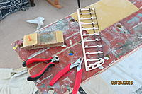 Name: IMG_1596.jpg Views: 394 Size: 747.1 KB Description: One of the V-tails, with the implements of destruction ready to hand. The heavy red pincers were used on the ply feet; the styrene cutters on the balsa feet.